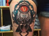 Татуировка жук и глаз