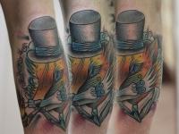 Татуировка лисица в шляпе на предплечье