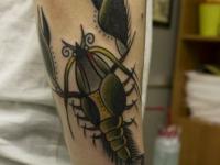 Татуировка рак на предплечье