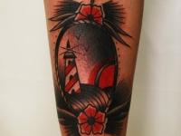 Татуировка маяк на голеностопе