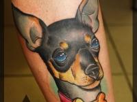Татуировка собака на голеностопе