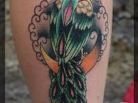 Татуировка павлин на голеностопе