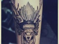Татуировка собака с рогами оленя
