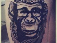 Татуировка обезьяна в очках