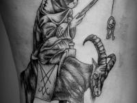 Татуировка кот на козе
