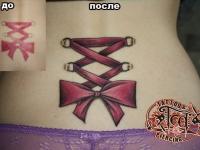 Татуировка шнуровка на спине