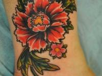 Татуировка пион на голеностопе
