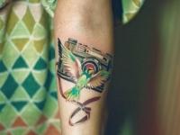 Татуировка фотоаппарат на предплечье