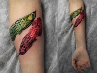 Татуировка рыбы на предплечье