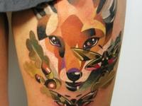 Татуировка лисица на бедре