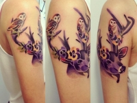 Татуировка олень на плече