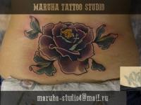 Татуировка роза на спине