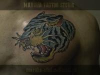 Татуировка голова тигра на груди