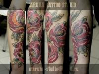 Татуировка розы на предплечье