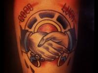 Татуировка рукопожатие