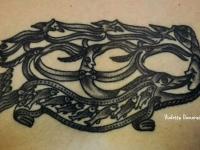 Татуировка рыбы на груди