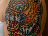 Татуировка ягуар на плече