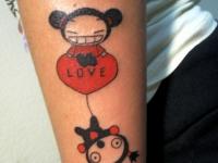 Татуировка мультик на плече