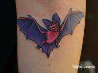 Татуировка летучая мышь на предплечье
