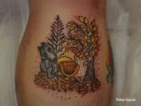 Печальный волк укачивает колыбельку возле дерева с опадающими листьями
