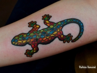 Татуировка ящерицы на предплечье