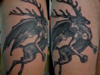 Татуировка олень с крыльями