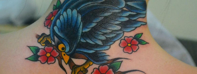 Татуировка птица.