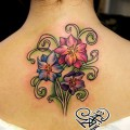 Художественная татуировка «Цветы». Мастер — Анна Корь. Расположение — спина. Время работы — 1,5 часа. По своему эскизу