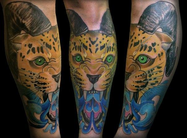 Художественная татуировка «Леопард с рогами» от Димы Поликарпова