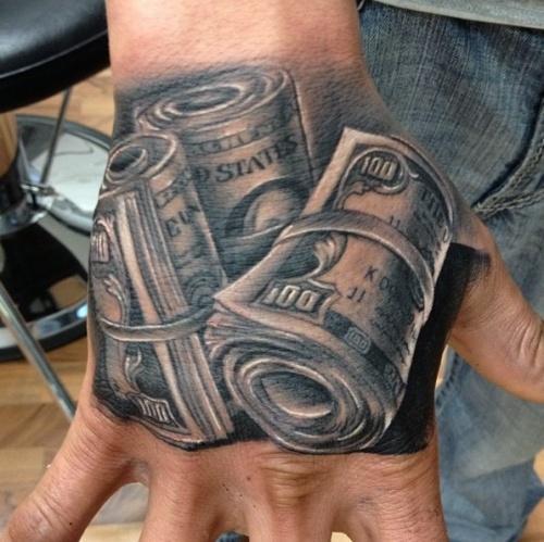 Татуировка доллары