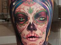 Татуировка череп девушки на икре