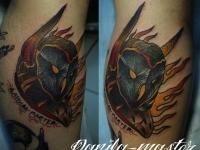 Татуировка сова на икре