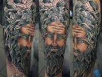 Татуировка лицо на предплечье