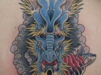 Татуировка зверь на спине