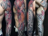 Татуировка страшного змея по всей руке