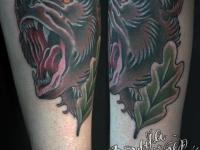 Татуировка на теле в виде головы медведя