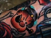 Татуировка рожица с трубкой
