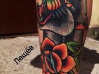 Татуировка пантера с цветком