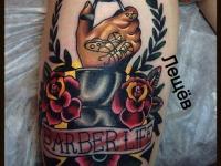 Татуировка клеймо на бедре