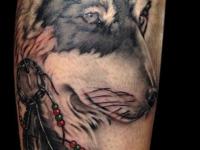 Татуировка волк на икре