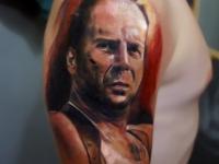 Татуировка портрет на плече