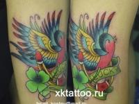 Татуировка птичка с подковой