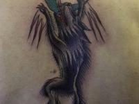 Татуировка волк на спине