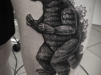 Татуировка годзилла на бедре