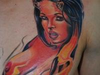 Татуировка девушка-черт на груди