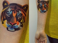 Татуировка тигр на предплечье