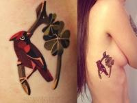 Татуировка птица на боку