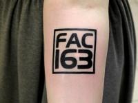 Татуировка знак на предплечье