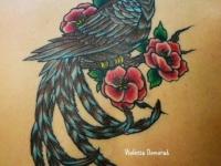 Татуировка птица на спине