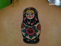 Татуировка матрешка на спине